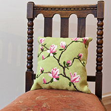 Spring blossom cushion on chair